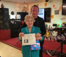 senior displaying her award