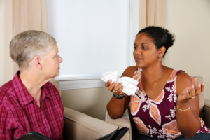 caregiver having a conversation with elderly woman